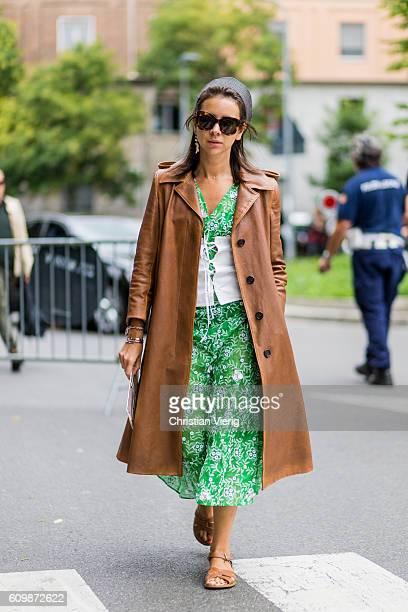 Natasha Goldenberg wearing a trench coat outside Fendi during Milan Fashion Week Spring/Summer 2017 on September 22 2016 in Milan Italy