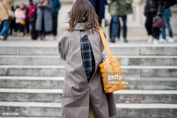 Natasha Goldenberg wearing coat with slit is seen outside Paco Rabanne on March 1 2018 in Paris France