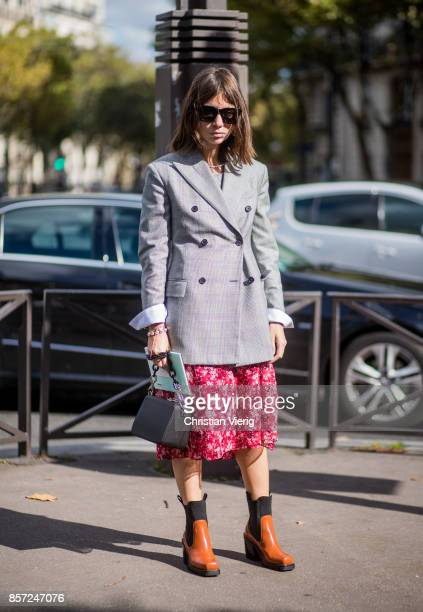 Natasha Goldenberg wearing grey checked blauer red skirt seen outside Miu Miu during Paris Fashion Week Spring/Summer 2018 on October 3 2017 in Paris...
