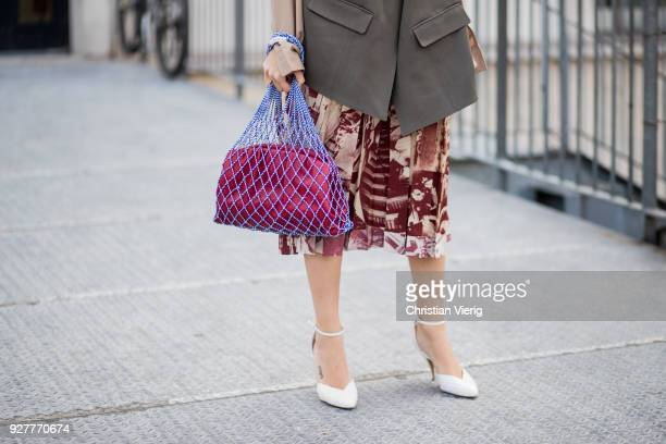 Natasha Goldenberg wearing net bag is seen outside Giambattista Valli during Paris Fashion Week Womenswear Fall/Winter 2018/2019 on March 5 2018 in...