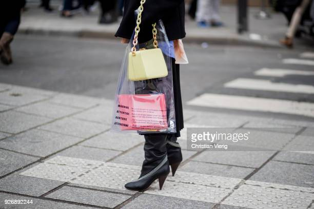 Natasha Goldenberg wearing plastic bag is seen outside Altuzarra during Paris Fashion Week Womenswear Fall/Winter 2018/2019 on March 3 2018 in Paris...