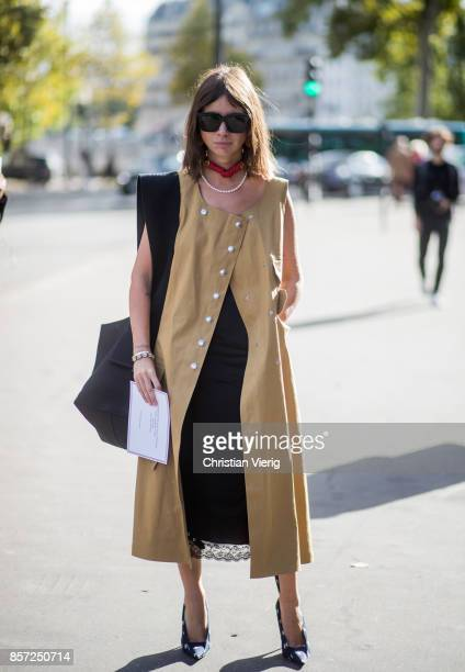 Natasha Goldenberg wearing sleeveless coat seen outside Thom Browne during Paris Fashion Week Spring/Summer 2018 on October 3 2017 in Paris France