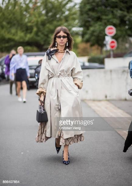 Natasha Goldenberg wearing trench coat seen outside Balenciaga during Paris Fashion Week Spring/Summer 2018 on October 1 2017 in Paris France