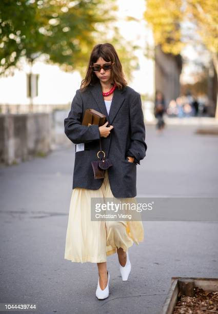 Natasha Goldenberg wearing yellow skirt black blazer white heels is seen outside Sacai during Paris Fashion Week Womenswear Spring/Summer 2019 on...