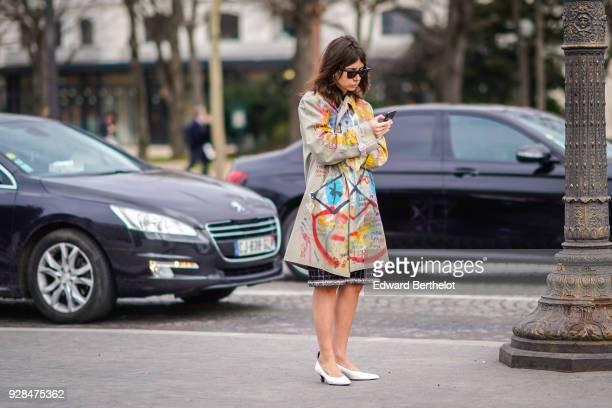 Natasha Goldenberg wears a multicolor print coat outside Chanel during Paris Fashion Week Womenswear Fall/Winter 2018/2019 on March 6 2018 in Paris...