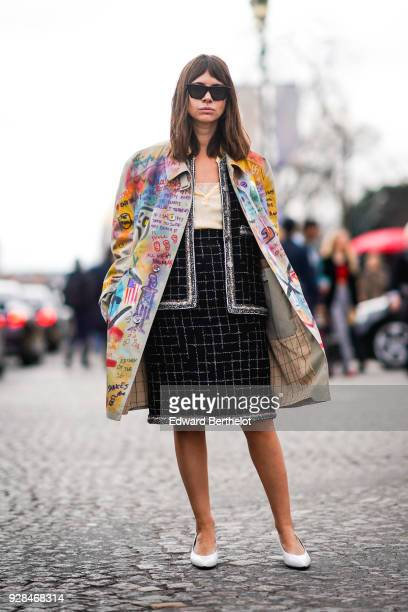 Natasha Goldenberg wears sunglasses a multi color jacket a tweed outfit white shoes outside Chanel during Paris Fashion Week Womenswear Fall/Winter...