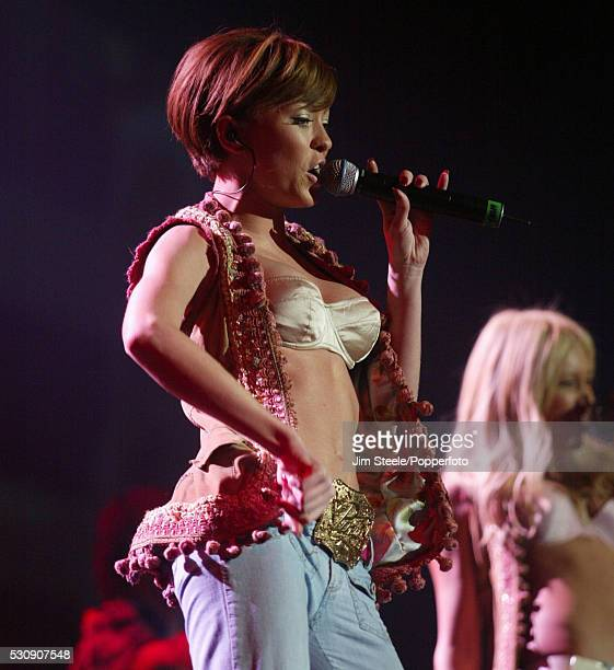 Natasha Hamilton of Atomic Kitten performing on stage at Wembley Arena in London on the 29th February 2004
