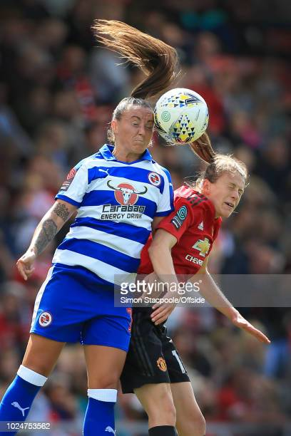 Natasha Harding of Reading battles with Lizzie Arnot of Man Utd as their hair goes everywhere during the FA WSL Continental Tyres Cup match between...