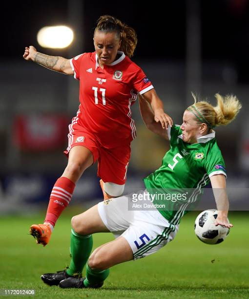 Natasha Harding of Wales is tackled by Julie Nelson of Norther Ireland during the UEFA Womens Euro Qualifier match between Wales and Northern Ireland...