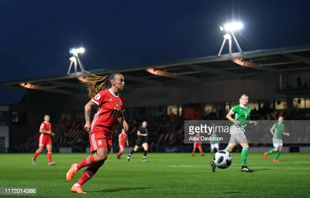 Natasha Harding of Wales runs down the wing during the UEFA Womens Euro Qualifier match between Wales and Northern Ireland at Rodney Parade on...