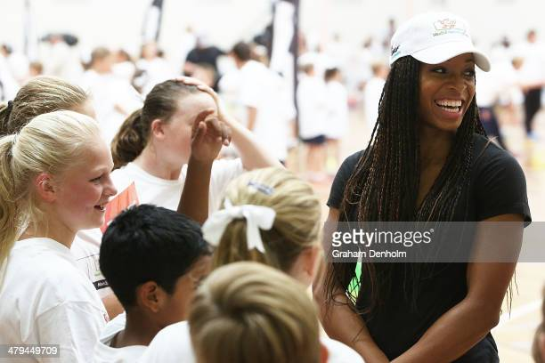 Natasha Hastings of the United States talks to a group of young boys and girls during the launch of the IAAF Nestle Healthy Active Kids Athletics at...