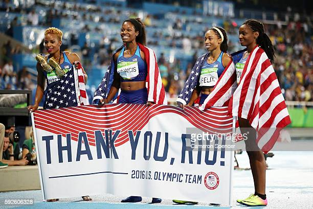 Natasha Hastings Phyllis Francis Allyson Felix and Courtney Okolo of the United States react after winning gold in the Women's 4 x 400 meter Relay on...