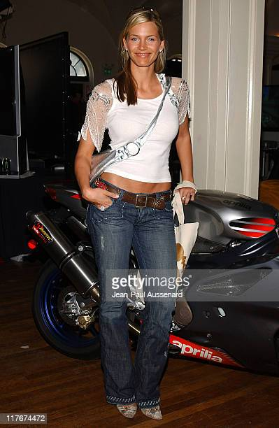 Natasha Henstridge and the Aprilia RSVR Factory Replica Photo by JeanPaul Aussenard/WireImage for Silver Spoon
