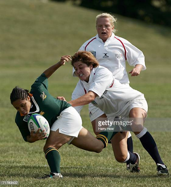 Natasha Hofmeester of South Africa is tackled by Shelley Rae and Amy Turner of England during the Women's Rugby World Cup at Ellerslie Park on...