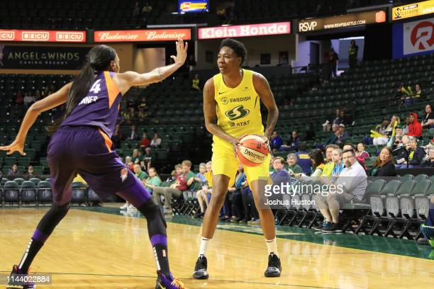Natasha Howard of Seattle Storm handles the ball against the Phoenix Mercury on May 15 2019 at the Angel of the Winds Arena in Everett Washington...