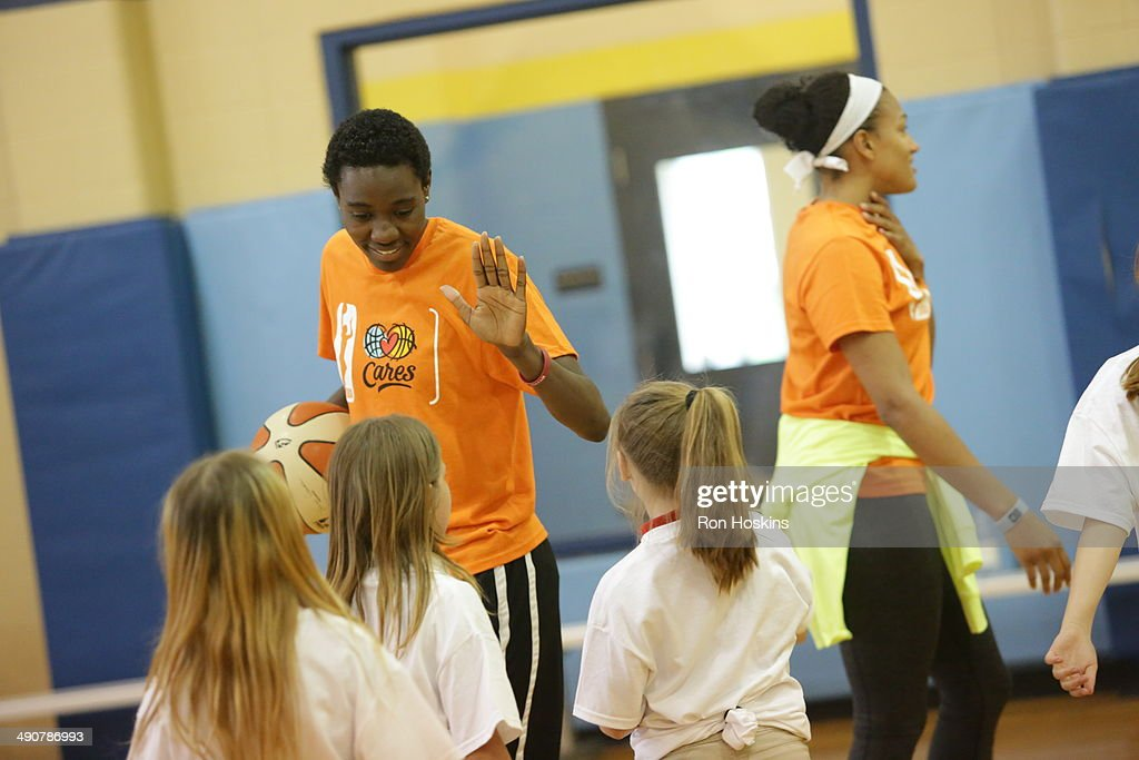 Natasha Howard #33 of the Indiana Fever participates in the Indiana Fevers 2014 Fever Cares Tipoff Event, in partnership with the Indy Parks Foundation and Indy Parks on May 14, 2014 at Garfield Park in Indianapolis, Indiana.