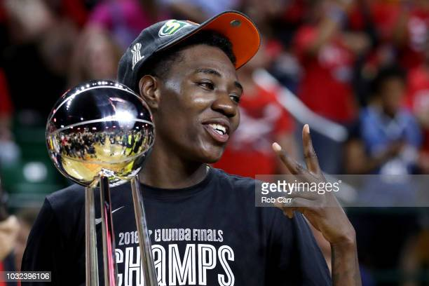 Natasha Howard of the Seattle Storm holds up the trophy after the Storm defeated the Washington Mystics 9882 to win the WNBA Finals at EagleBank...