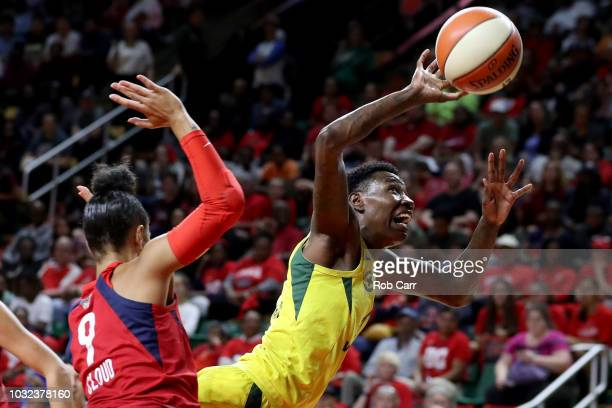 Natasha Howard of the Seattle Storm is fouled by Natasha Cloud of the Washington Mystics in the first half during game three of the WNBA Finals at...