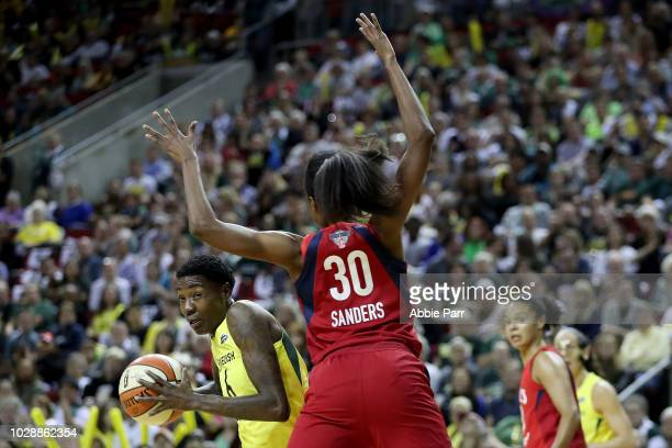 Natasha Howard of the Seattle Storm works against LaToya Sanders of the Washington Mystics in the first quarter during game one of the WNBA Finals at...