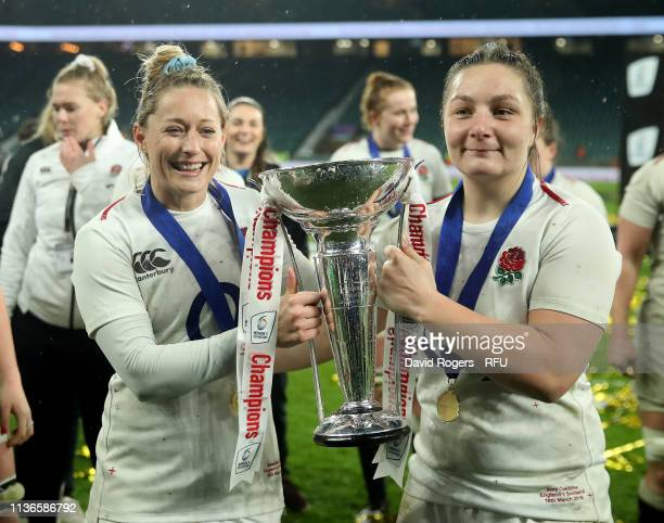 Natasha Hunt and Amy Cokayne of England celebrate with the trophy after England win the Grand Slam during the Guinness Women's Six Nations match...