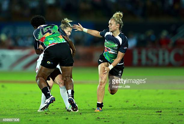 Natasha Hunt of England is tackled in th match against Fiji during the IRB Women's Sevens World Series Cup Final on December 5 2014 in Dubai United...