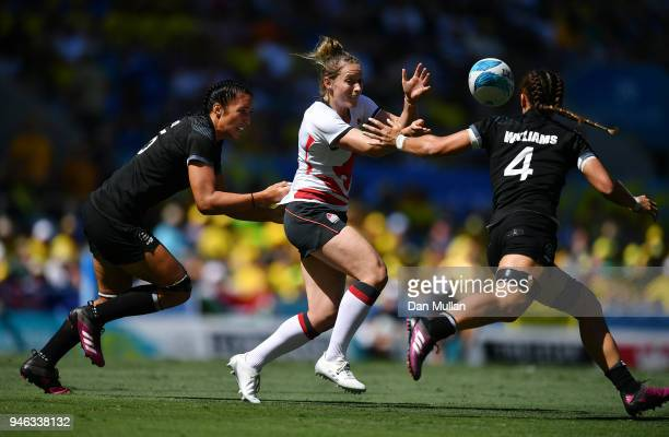 Natasha Hunt of England releases a pass under pressure during the Rugby Sevens Women's SemiFinal between New Zealand and England on day 11 of the...