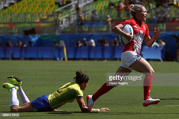 Natasha Hunt of Great Britain scores a try past Claudia Jaqueline Teles of Brazil during a Women's Pool C rugby match between Great Britain and...
