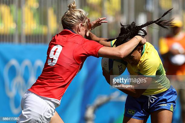 Natasha Hunt of Great Britain tackles Edna Santini of Brazil during a Women's Pool C rugby match between Great Britain and Brazil on Day 1 of the Rio...