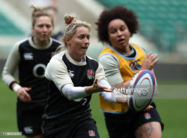 Natasha Hunt passes the ball during the England Women's captain's run at Twickenham Stadium on March 15 2019 in London England