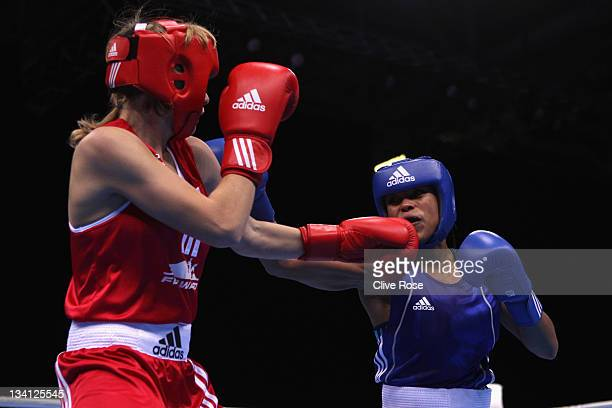 Natasha Jonas of Great Britain in action during her Women's Light Welter weight boxing match against Anastasia Belyakova of Russia during the LOCOG...