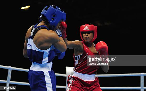 Natasha Jonas of Great Britain punches Quanitta Underwood of USA during their quaterfinal 57kg60kg bout at ExCel on November 25 2011 in London England