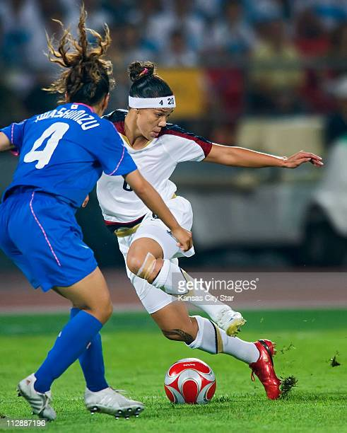 Natasha Kai of the United States dribbles by Azusa Iwashimizu of Japan on Monday August 18 in the Games of the XXIX Olympiad in Beijing China