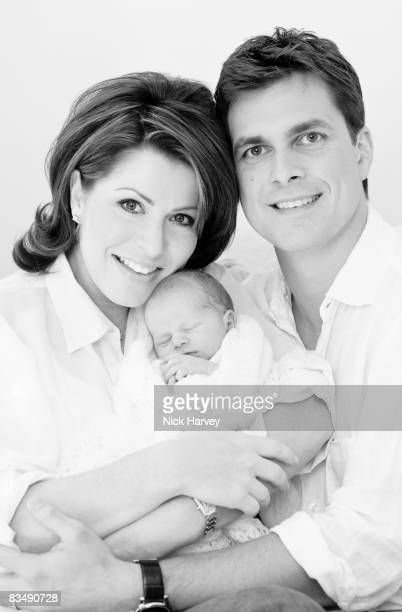 COVERAGE** Natasha Kaplinsky and husband Justin Bower pose for a portrait session with their newborn son on September 29 2008 in London England