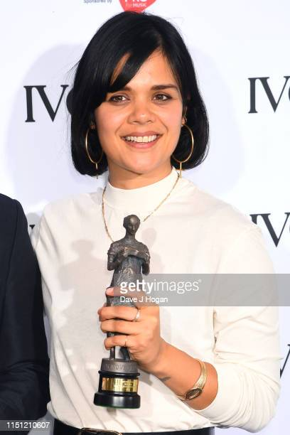 Natasha Khan, winner for Best Television Soundtrack, poses in the winners room at The Ivors 2019 in the winners room at The Ivors 2019 at Grosvenor...