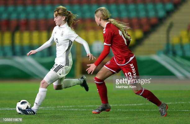 Natasha Kowalski of Germany challenges for the ball with Mille Jusjong of Denmark during the U16 Girl's international friendly match between Germany...