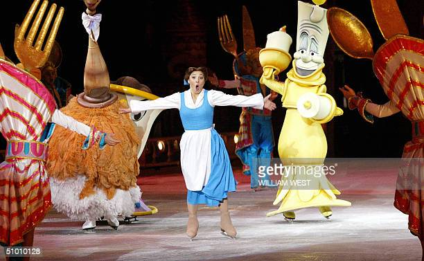 Natasha Kuchiki starring as Belle in the Disney On Ice production of Beauty and the Beast sings amid the Enchanted objects during the premier in...