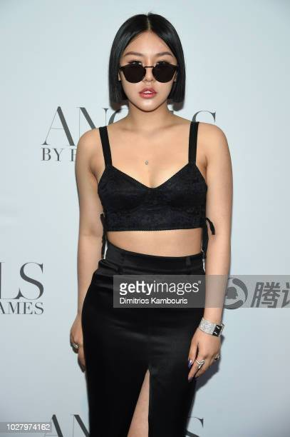 Natasha Lau attends the ANGELS by Russell James book launch and exhibit hosted by Cindy Crawford and Candice Swanepoel at Stephan Weiss Studio on...
