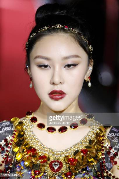 Natasha Lau walks the runway at the Dolce Gabbana secret show during Milan Fashion Week Spring/Summer 2018 at Bar Martini on September 23 2017 in...