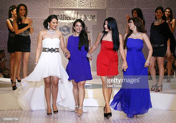 Natasha Madhwani Sonakshi Sinha Tanya Deol Maheep Kapoor and Ayesha Takia walk the ramp at Day II of the HDIL Couture fashion week in Mumbai on...