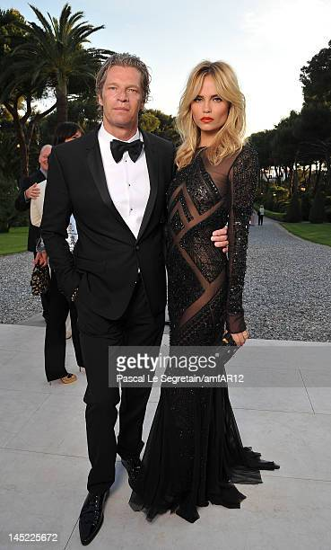 Natasha Poly and Peter Bakker attend the 2012 amfAR's Cinema Against AIDS during the 65th Annual Cannes Film Festival at Hotel Du Cap on May 24 2012...