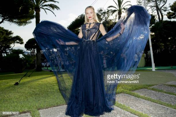 Natasha Poly attends the cocktail at the amfAR Gala Cannes 2018 at Hotel du CapEdenRoc on May 17 2018 in Cap d'Antibes France