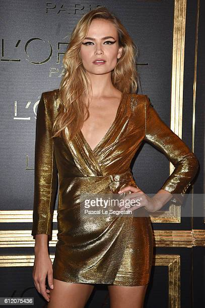 Natasha Poly attends the Gold Obsession Party L'Oreal Paris Photocall as part of the Paris Fashion Week Womenswear Spring/Summer 2017 on October 2...