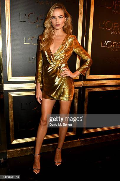 Natasha Poly attends the L'Oreal Paris Gold Obsession Party at Hotel de la Monnaie on October 2 2016 in Paris France