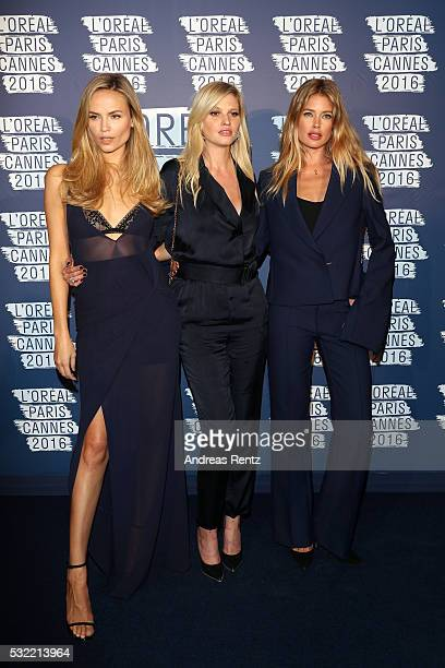 Natasha Poly Lara Stone and Doutzen Kroes attend the L'Oreal Party during the annual 69th Cannes Film Festival at on May 18 2016 in Cannes France