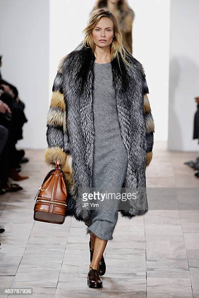 Natasha Poly walks the runway at the Michael Kors fashion show during Mercedes-Benz Fashion Week Fall at Spring Studios on February 18, 2015 in New...