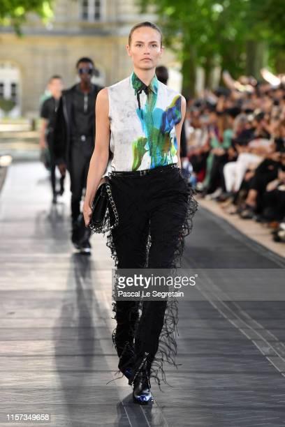 Natasha Poly walks the runway during the Berluti Menswear Spring Summer 2020 show as part of Paris Fashion Week on June 21, 2019 in Paris, France.