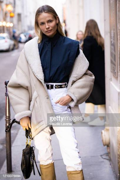Natasha Poly, wearing a blue shirt, white jeans and beige jacket, is seen outside Isabel Marant, during Paris Fashion Week - Womenswear Fall/Winter...