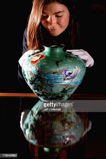 Natasha Raskin views a unique Japanese vase made by renowned Japanese artist Kumeno Teitaro sold for GBP £17000 in McTears Asian Works of Art sale on...