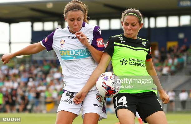 Natasha Rigby of Perth and Ashleigh Sykes of Canberra contest possession during the round five WLeague match between Canberra United and Perth Glory...