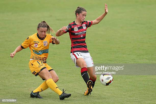 Natasha Rigby of the Glory is challenged by Rachel Lowe of the Wanderers during the round 14 WLeague match between the Western Sydney Wanderers and...